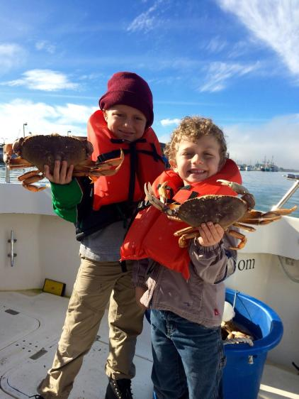 Young anglers Jacobi and Jaxon are all smiles as they hold a couple Dungeness crab caught while fishing last Saturday with Gary Blasi of Full Throttle Sport Fishing. Sport crabbing, which opened Nov. 1 along the North Coast, has been excellent out of Eureka. Photo courtesy of Full Throttle Sport Fishing