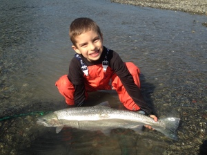 Six-year old Jackson Stratman of Eureka poses with his Eel River steelhead, which he hooked, fought, and landed all by himself on trip with his dad earlier this week. Photo courtesy of Mike Stratman/Redwood Coast Fishing