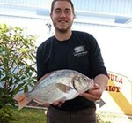 2014 Perch'n on the Peninsula Surfperch Fishing Tournament winner Tyler Vaughn with his Tournament Record Redtail surfperch that measured 16.6 inches. This year's tournament is taking place April 18. Photo courtesy of Samoa Peninsula Fire District