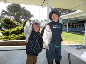 Brothers Oliver, left, and Sammy Luna of McKinleyville show off their catches after last Saturday's Perch n' on the Pennnsula tournament. Eight-year old Sammy took home first place honors in the Junior category while younger brother Oliver, age 5, took second. Photo courtesy of the Samoa Peninsula Fire District