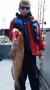 Montana resident Wyatt Sholly landed this nice lingcod on Tuesday while fishing near Cape Mendocino with Matt Dallam of Northwind Charters. Sholly was fishing with his brother Ethan as well as parents Jon and Barb .Photo courtesy of Northwind Charters