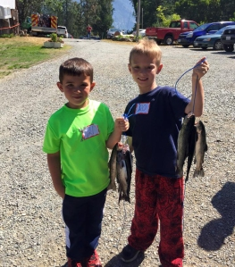 Young anglers Blake Santos, pictured left, and Conner Jones show off their catch from last Saturday's SkyCrest Lake Youth Fish Derby held at SkyCrest Lake in Burnt Ranch. Both Santos and Jones, who reside in McKinleyville, caught their limit of trout using bobbers and salmon eggs. Photo courtesy of Mark Santos