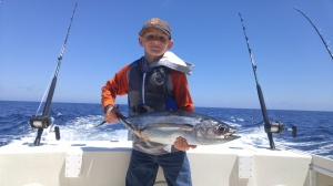 10 -year old Austin Scilacci had his hands full landing his first-ever tuna while fishing near Crescent City last Friday. Austin , along with his father Bryan, were fishing with Marc Schmidt of Coastline Charters. Photo courtesy of Bryan Scilacci