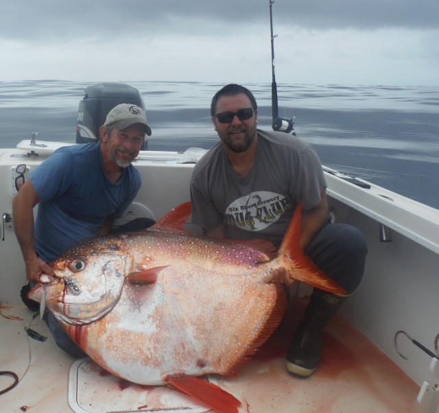 After an hour and 15-minute battle, Chuck Chastain, pictured left, landed this 114-pound Opah on Tuesday while tuna fishing 75 miles west of Eureka. Chastain was fishing with Captain Marc Schmidt, pictured right, of Coastline Charters. Opahs are typically found in the warm waters off Hawaii and are rarely caught by sport anglers. The meat is said to be rich and tasty and highly sought after, especially in the restaurant trade. Photo courtesy of Marc Schmidt/Coastline Charters