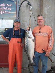Ron Wallace of Sebastopol, pictured right, landed the winning salmon in Englund Marine's big salmon contest. The first place fish weighed in at 29 lbs gutted and gilled and was caught on July 21. Wallace was fishing with Tim Klassen of Reel Steel Sport Fishing, pictured left. Photo courtesy of Englund Marine, Eureka