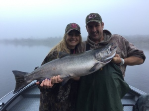 Crescent City resident Trina Gheen, with the help of Jason Costello, pictured right, landed her first-ever Klamath River salmon last week while fishing with guide Mike Coopman. Photo courtesy of Mike Coopman's Guide Service