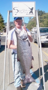 Mark Rowland is currently in first place in the Chetco Bubble season Hawg Derby with this 45-pound salmon. The big king was landed on October 2. First place in the derby, which ends Sunday, is worth $3,000 Photo courtesy of Sporthaven Marina, Brookings